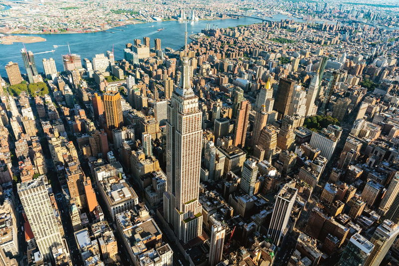 Aerial View Of Empire State Building Amidst Towers At Manhattan