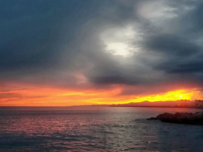Today's sunset. Mobilephotography Mountain Horizon Over Water Water Sea Sunset Multi Colored Reflection Sky Horizon Over Water Cloud - Sky Dramatic Sky Seascape Moody Sky Calm Coast Shore