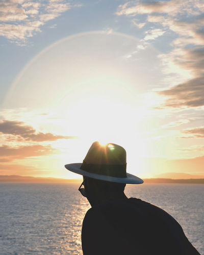Beach Beauty In Nature Cloud - Sky Day Hat Headshot Horizon Over Water Leisure Activity Lifestyles Nature One Person Outdoors Real People Rear View Scenics Sea Silhouette Sky Sun Sunlight Sunset Tranquil Scene Tranquility Water Women