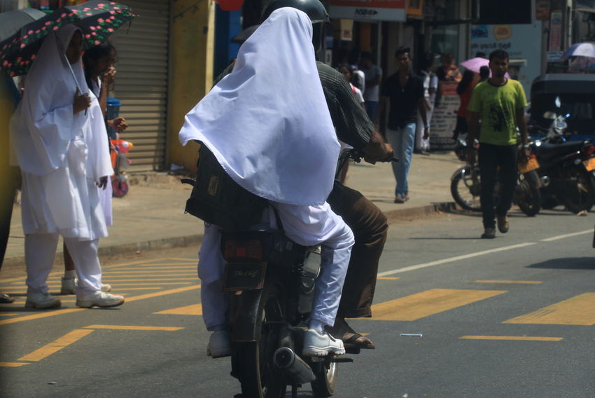 City City Life City Street Day Focus On Foreground Girl Group Of People Lifestyles Man Mode Of Transport Motorcycle Muslims Outdoors Pedestrian Crossing Road Sri Lanka Street