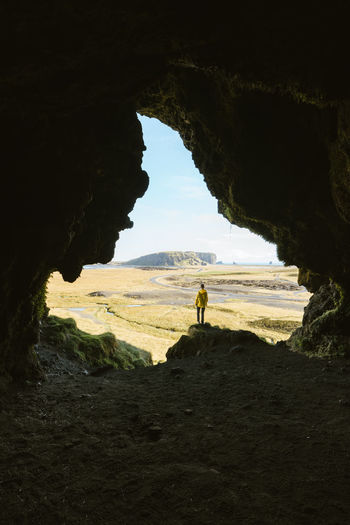 Check out my prints at https://www.etsy.com/shop/simonmigajphoto and visit my IG http://www.instagram.com/simonmigaj for more inspirational photography from around the world. Exploring the caves of Iceland Nature Rock Lifestyles Real People Land People Cave Day Leisure Activity Arch Men Rock - Object Rock Formation Sky Rear View Standing Sea Solid Beauty In Nature Outdoors Iceland Spelunking Landscape Composition