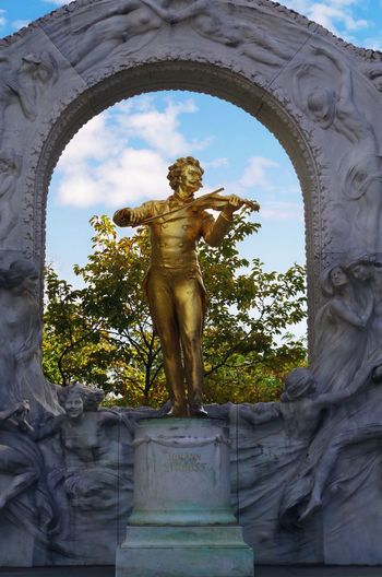 Park Trip Vienna Sightseeing Johann Strauss Representation Sculpture Human Representation Art And Craft Statue Creativity Architecture Arch Low Angle View Built Structure Male Likeness No People History Sky Belief Plant Day Craft The Past Outdoors