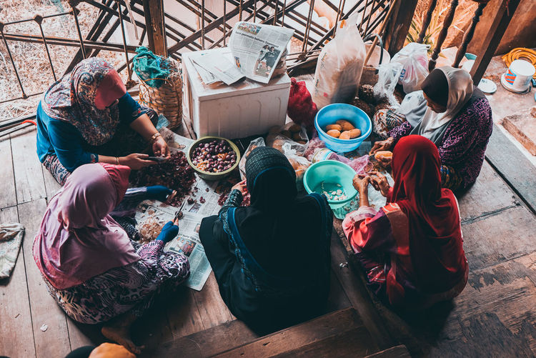 High angle view of people sitting in kitchen