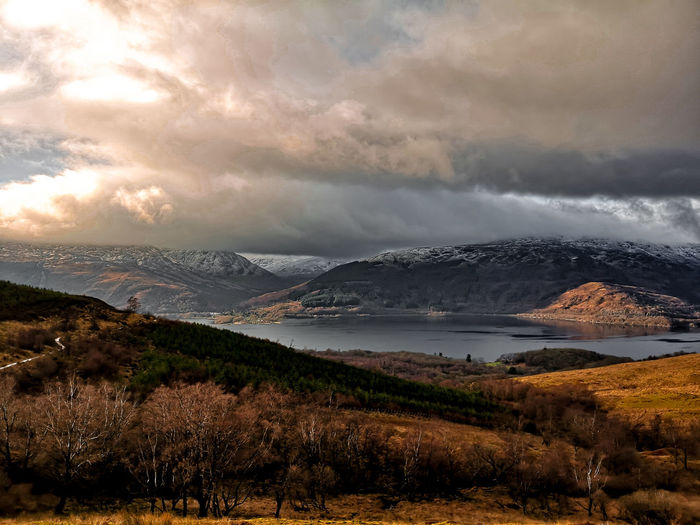 In awe Ben Lomond Scotland View Scenic View Lake Water Loch Lomond Shores Loch Lomond Mountain Sea Beach Sunset Water Dramatic Sky Sky Landscape Cloud - Sky Mountain Range Mountain Peak Scenics Tranquil Scene Idyllic Calm Tranquility Countryside Non-urban Scene Weather Storm Cloud Extreme Weather