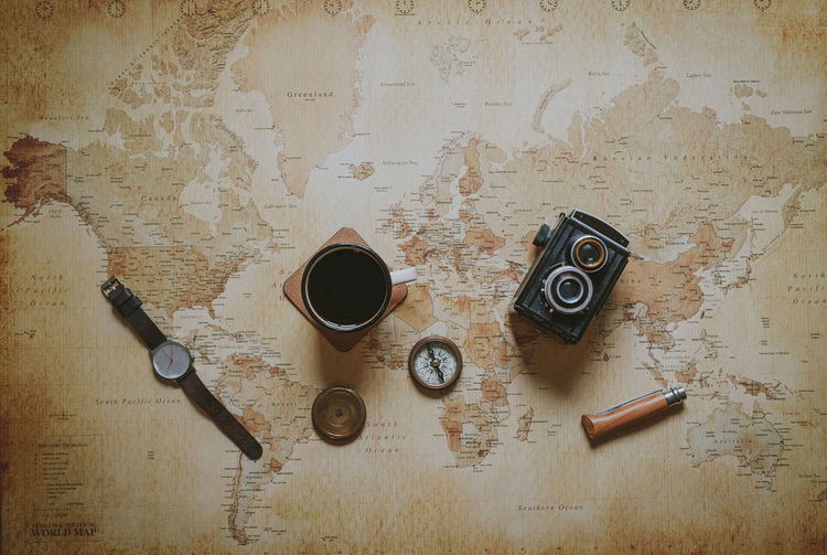 Directly Above No People High Angle View Coffee Watch Compass Camera Vintage Camera Medium Format Explore Planning World Map Map Travel Travel Photography Flatlay Coffee Coffee Cup