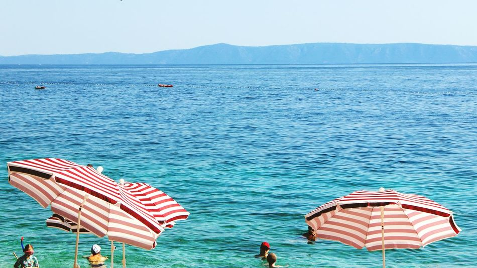 Red And Blue Warm And Cold Beach Croatia Brela Beach Sea Blue Two Is Better Than One EyeEm On The Way Summer Still Life Relax Outdoor Photography Holiday Parasol Chillout Sunshine Stripes Pattern A Birds's Eye View The Week On EyeEm Water