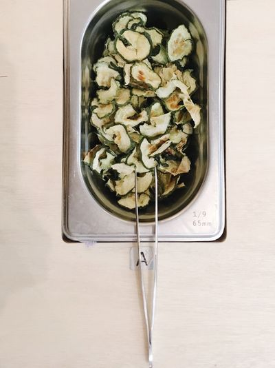 High angle view of dried cucumber in bowl on table