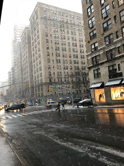 Architecture Land Vehicle Car Building Exterior Built Structure Wet Mode Of Transport Outdoors Road Transportation City Winter Skyscraper Snow Day