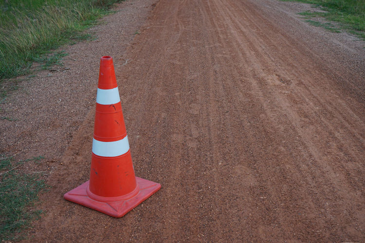 High angle view of traffic cone on dirt road