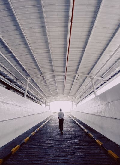 A man walking out of the tunnel