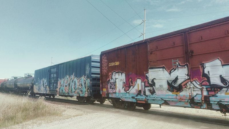 Graffiti Clear Sky Train Train Graffiti  Road Building Exterior Day Blue Outdoors Sky No People Creativity Iowa Rural Scene Countryside