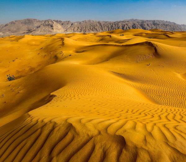 The Hajar Mountain range Desert Landscape Scenics - Nature Climate Environment Arid Climate Tranquil Scene Sand Dune Tranquility Beauty In Nature Sand Land Non-urban Scene Nature Sky Remote Physical Geography No People Day Extreme Terrain Outdoors Atmospheric Hajar Mountain Mountain Range