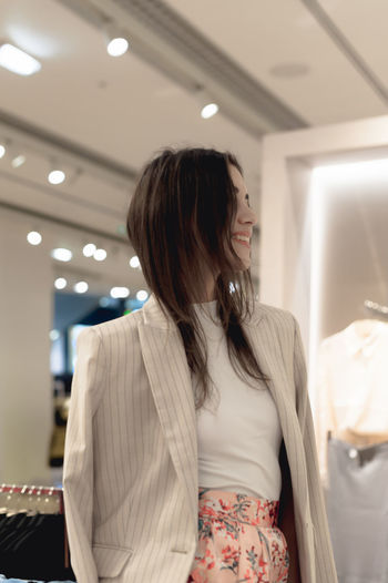 One Person Real People Women Indoors  Standing Waist Up Adult Leisure Activity Hairstyle Front View Casual Clothing Young Women Looking Brown Hair Illuminated Lifestyles Young Adult Focus On Foreground Hair Ceiling Contemplation Beautiful Woman