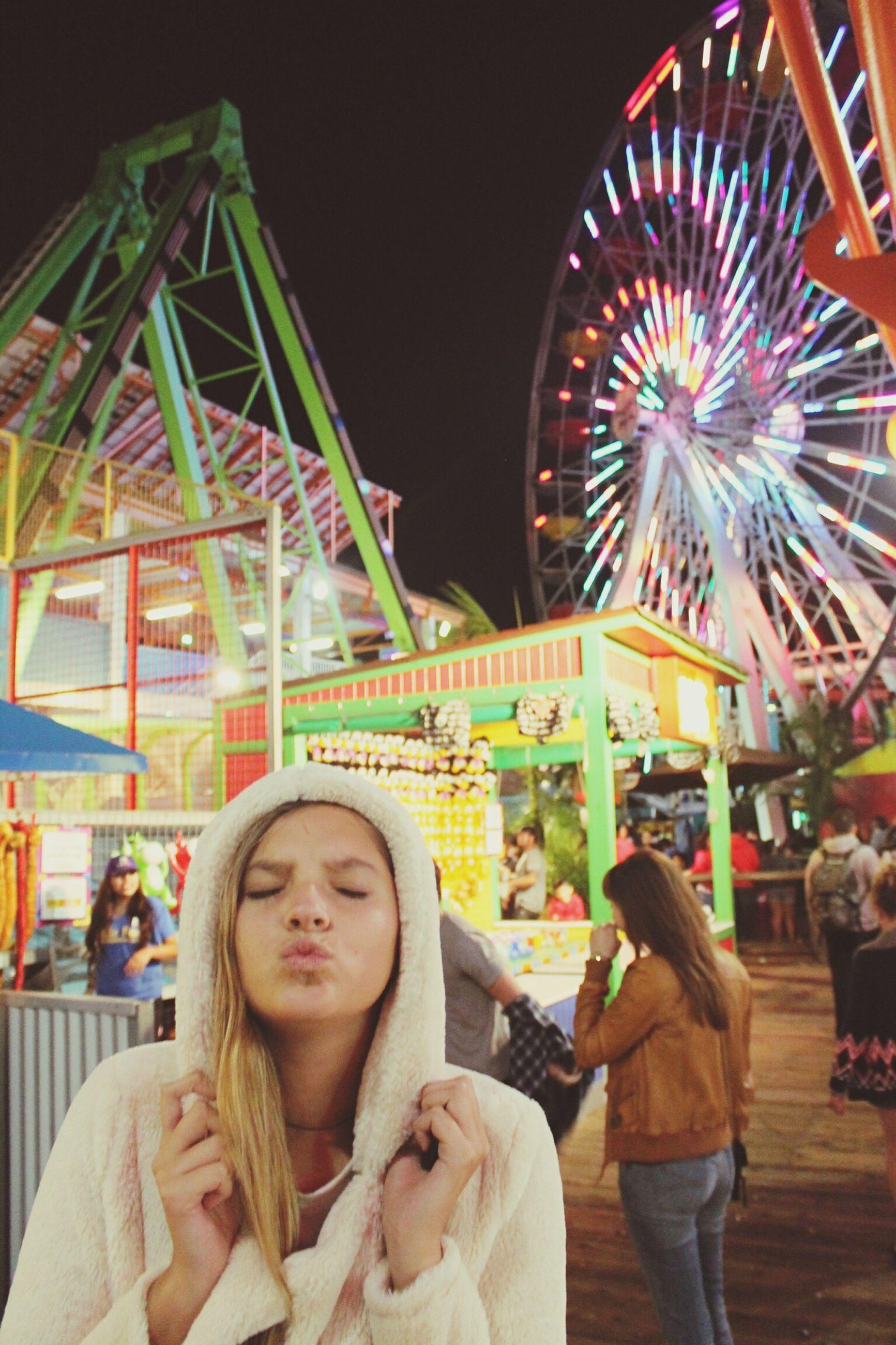 leisure activity, amusement park, arts culture and entertainment, lifestyles, amusement park ride, illuminated, large group of people, fun, person, night, enjoyment, architecture, celebration, built structure, men, carousel, tourism, ferris wheel