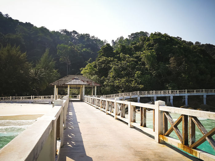 Pulau Redang, Malaysia. Tree Plant Architecture Built Structure Nature Sky Water Railing Day Clear Sky Sunlight Bridge Connection No People Direction The Way Forward Growth Tranquility Outdoors Footbridge Swimming Pool Ocean Snorkeling Malaysia Jetty Travel Destinations Tropical Island Turquoise Water Beautiful Nature