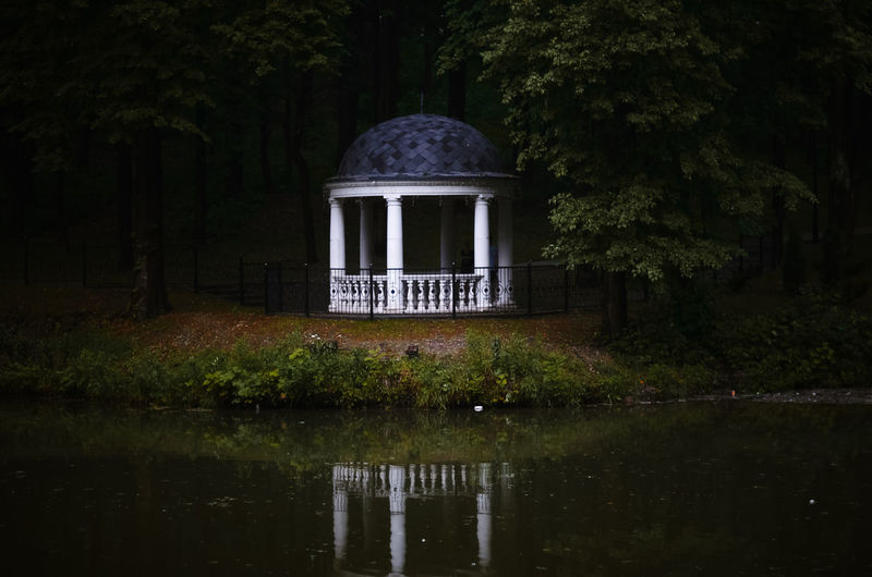 Built structure by lake in forest