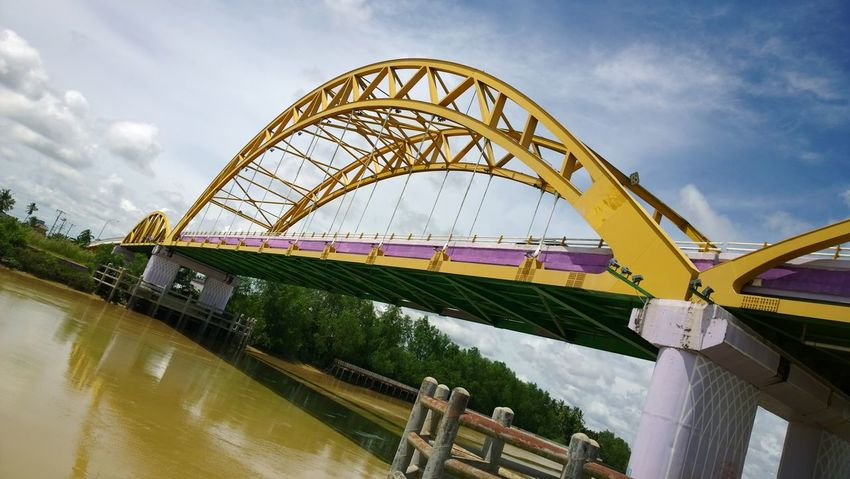 Cloud - Sky Bridge - Man Made Structure Water Sky Arts Culture And Entertainment Day People Outdoors Yellow River Bridge No People Indonesian Street (Mobile) Photographie Indonesia_photography INDONESIA