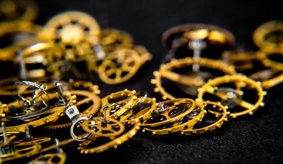 close view of a vintage toothed wheels watch mechanism with jewels Vintage Toothed Wheels Close View Of A Vintage Toothed Wheels Watch Mechanism With Jewels Clock Whell Toothed Whale Indoors  Close-up No People Selective Focus Metal Studio Shot Jewelry Gear Black Background Equipment Complexity Still Life Gold Colored Machinery Machine Part Gold Large Group Of Objects Watch Fashion Group Luxury My Best Photo