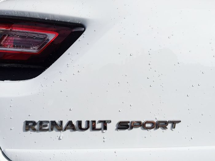 Clio 4 R.S. Trophy 220ch 280Nm Team Sport Sport Time Taking Photos Portrait Renault Sport Sport Car Motor Vehicle Communication Mode Of Transportation Text Transportation No People Water Wet Day Drop Outdoors Red RainDrop Glass - Material Land Vehicle