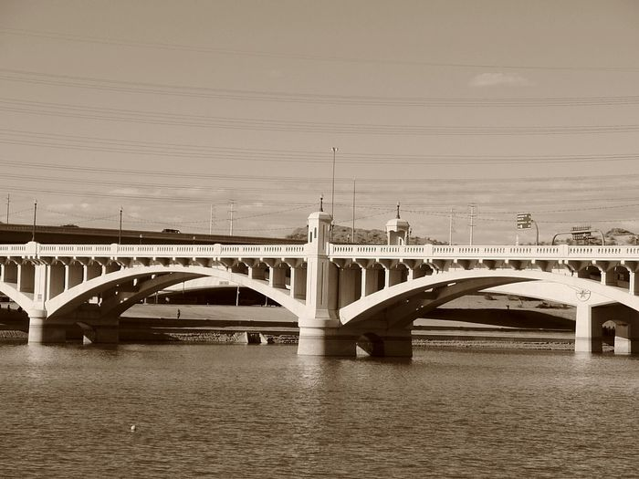 The old Mill Avenue Bridge over Tempe Town Lake (the Salt River). Bridge - Man Made Structure Travel Destinations Built Structure Architecture No People Outdoors Water Day Sky City Tempe Town Lake Tempe Arizona Bridges EyEmNewHere Artiseverywhere Girder Mill Avenue Bridge Old Mill Avenue Bridge Original Mill Avenue Bridge Salt River Landmarks The Architect - 2017 EyeEm Awards