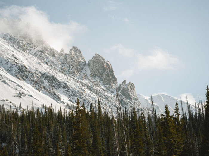 Sunny day with clouds surrounding cameron peak in colorado.