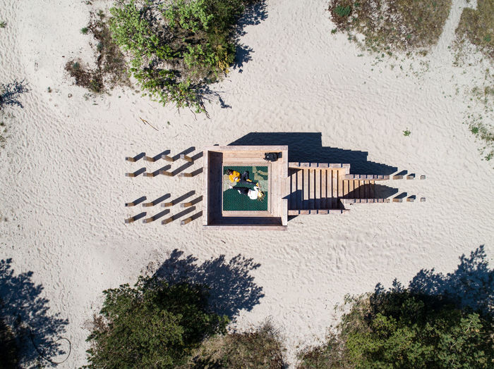 Above Aerial View Sand Sculpture Modern Architecture Hammock Seaside People Lying Down Couple Private Secret Summer Shadow Comfortable Cosy Together Lithuania Nida City Built Structure High Angle View Sunlight Beach Architecture Design Capture Tomorrow
