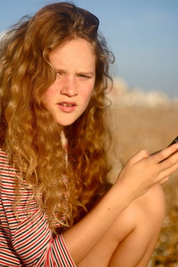 Close-Up Of Teenager Against Sky