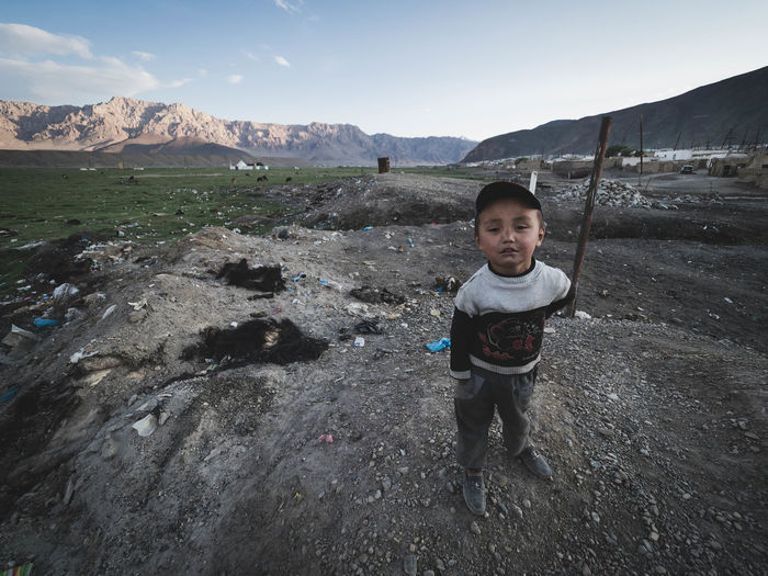 A young boy stops to pose for a photo atop a dirty mound of rubbish littered with fur from the local animals that have perished. Astronomy Boys Child Childhood Day Full Length Leisure Activity Males  Men Murg Murghob Nature Outdoors Portrait Poverty Real People Sky Tajiistan Week On Eyeem The Photojournalist - 2018 EyeEm Awards The Great Outdoors - 2018 EyeEm Awards The Traveler - 2018 EyeEm Awards The Portraitist - 2018 EyeEm Awards The Street Photographer - 2018 EyeEm Awards Capture Tomorrow