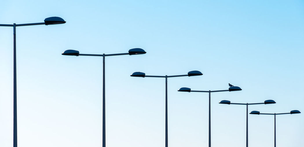 Low angle view of street light against clear sky