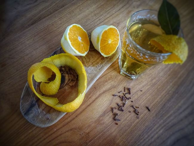 Bay Leaves Cloves Hot Drink Winter Fall Food And Drink Table Citrus Fruit Fruit Freshness Indoors  SLICE High Angle View No People Food Wood - Material Healthy Eating Day Sour Taste Blood Orange Ingredients