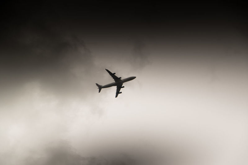 low flying plane due to the stormy weather Air Vehicle Airplane Cloud - Sky Cloudy Commercial Airplane Flying Journey Low Angle View Mid-air Military Airplane Mode Of Transport Motion On The Move Public Transportation Silhouette Sky Speed Transportation Travel
