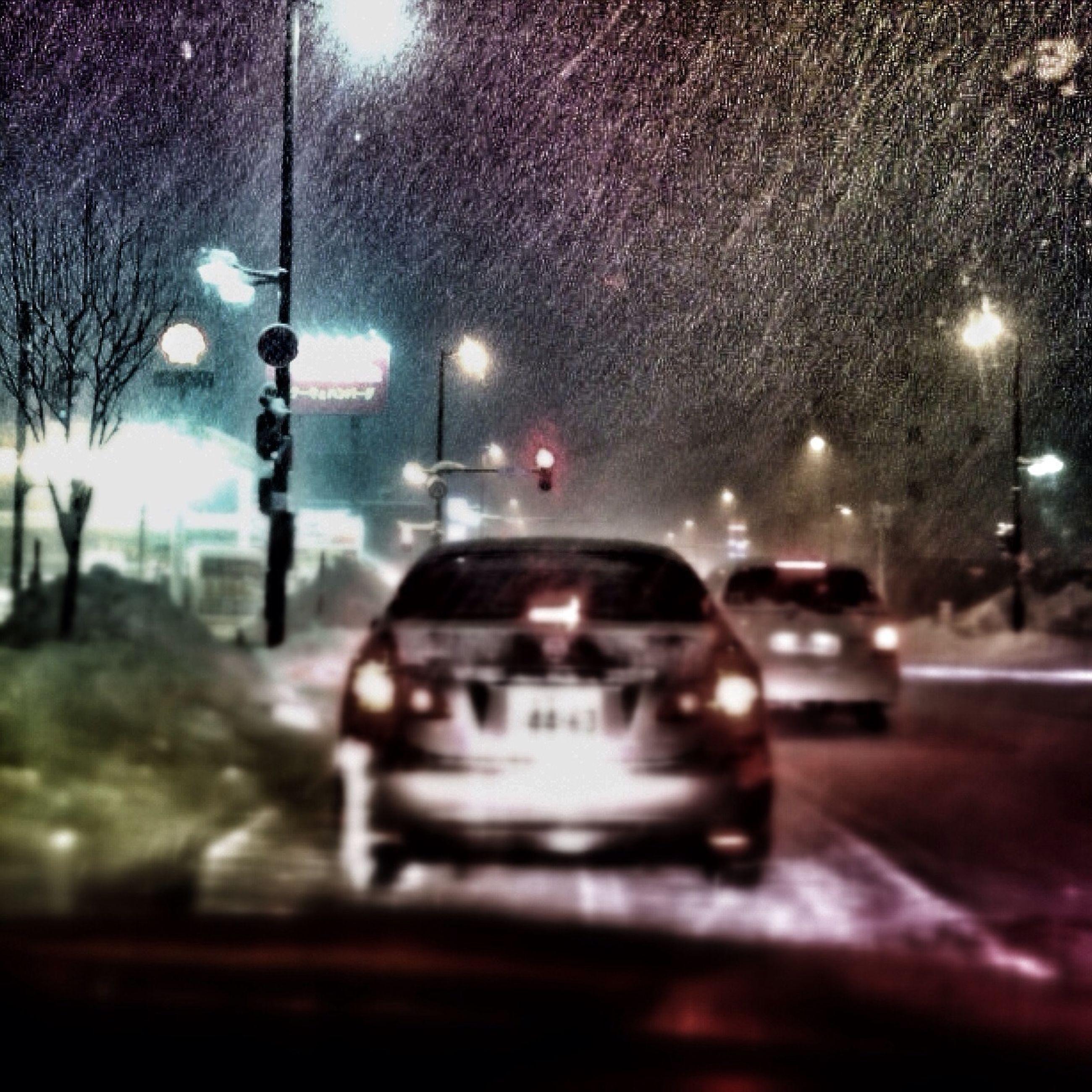 transportation, car, land vehicle, mode of transport, illuminated, night, windshield, street light, wet, transparent, street, glass - material, rain, headlight, road, vehicle interior, on the move, season, travel, traffic