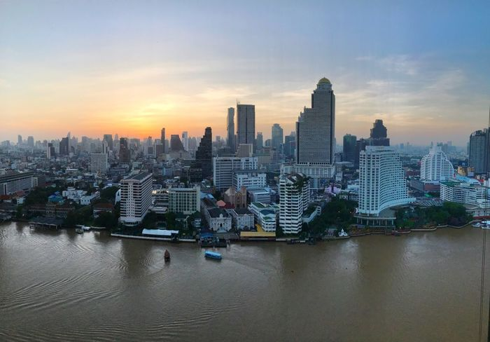 Sunrise Dawn Cityscape City Architecture Skyscraper Urban Skyline Sky Modern Waterfront Travel Destinations Bangkok Chaophraya River Water Outdoors Downtown District No People River Built Structure Building Exterior Panorama