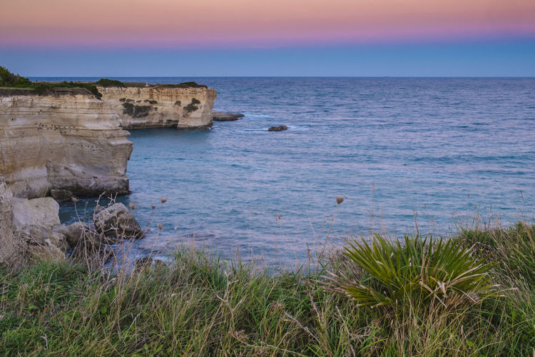 Beach Beauty In Nature Coast Coastline Horizon Over Water Italy Nature Outdoors Rock Formation Rocks Rocky Beach Rocky Coastline Salento Scenics Sea Sky Sunset Sunset_collection Tranquil Scene Tranquility Travel Destinations Travel Photography Traveling Water Waves, Ocean, Nature Live For The Story