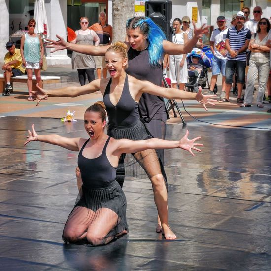 Dancers and Tourists in Nerja Andalucía SPAIN España Contrast Dance Dancing Performance Performing Arts Event Balance Real People Lifestyles Large Group Of People Skill  Women Togetherness Aggressive Shouting The Street Photographer - 2017 EyeEm Awards Streetphotography Street Photography Streetphoto_color Tourism