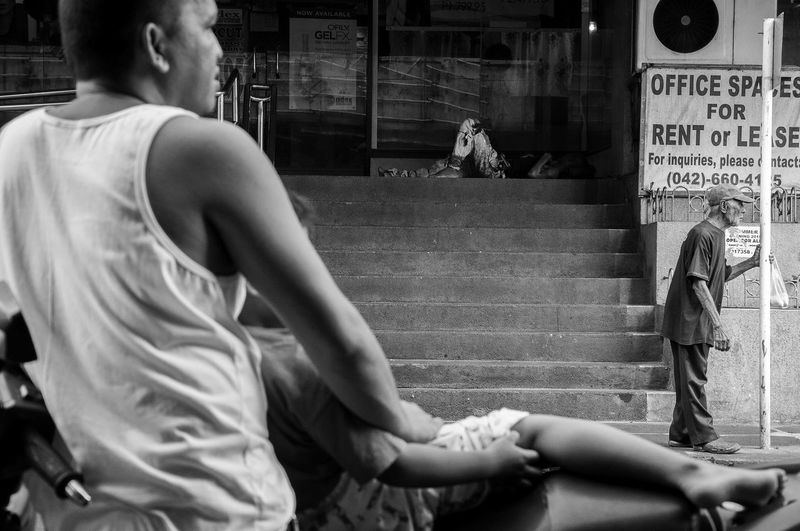 Flaneuring in Black and White Eyeem Philippines Father & Son Philippines Street Street Photography Streetphoto Streetphoto_bw Streetphotography Streetphotography_bw The Street Photographer - 2016 EyeEm Awards