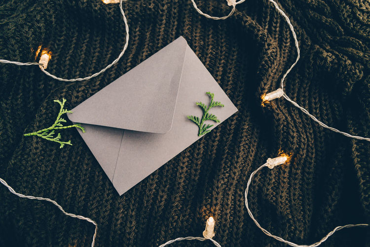 Autumn Mockup Concept Sheet Letter Winter Fall Flat Lay Top Envelope View Above Festoon Warm Sweater November October Cozy Cosy Christmas Thanksgiving Holidays Weather Moody Message Blank Empty Text Background Trend Photography Still Life Lights Decor Cloth Rainy Mood