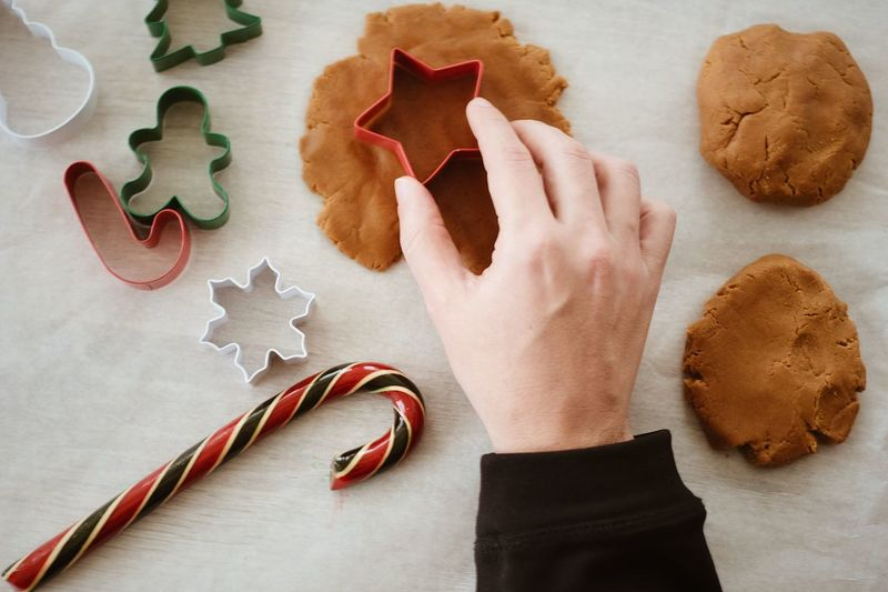 Foodphotography Christmas Decorations Xmas Hands At Work Celebrations Holidays Baking Christmas Time Christmastime DIY Human Hand Human Body Part Indoors  One Person High Angle View Table Christmas Cookie Shape Holiday Celebration Art And Craft Creativity Still Life Food And Drink Star Shape Baked Holiday Moments Moments Of Happiness