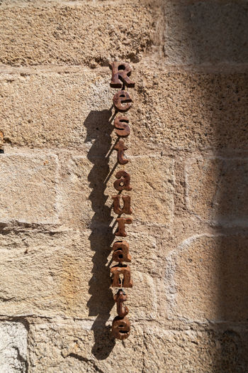 Low angle view of cross on wall