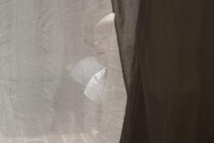 Digital composite image of woman seen through glass window