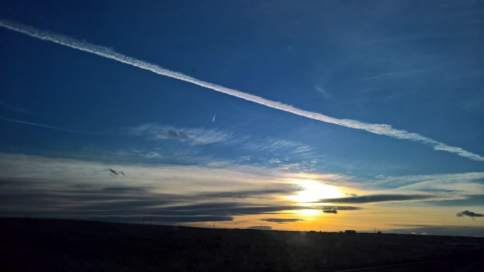 Beauty In Nature Blue Contrail Day Low Angle View Nature No People Outdoors Scenics Sky Sunset Tranquil Scene Tranquility Vapor Trail
