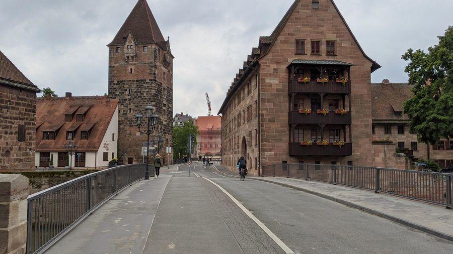 Road amidst buildings against sky in city