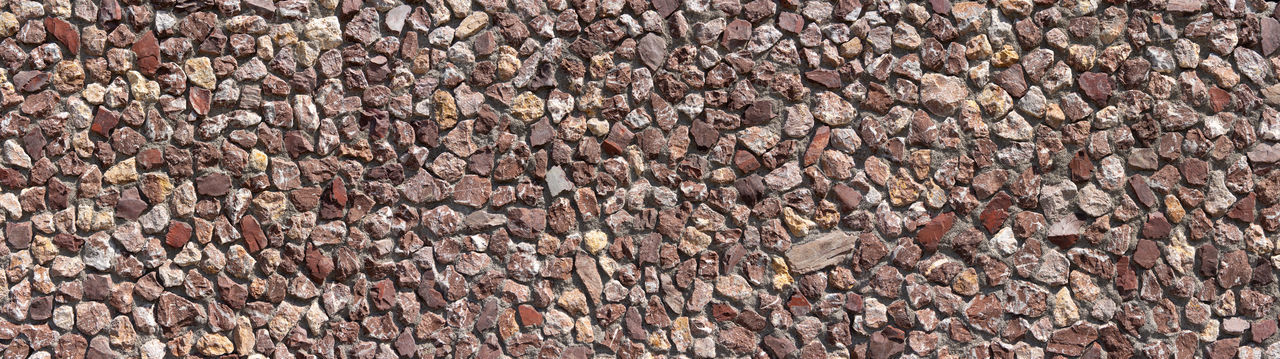 Panoramic shot of a wall of mainly reddish, coarse stones Architecture Detail Photography Exterior Panoramic Red Textured  Wall Architectural Background Close-up Closeup Coarse Header Masonry Natural Stone Pattern Patterned Red Brown Reddish Rough Stone Stone Wall Structure Texture Uneven