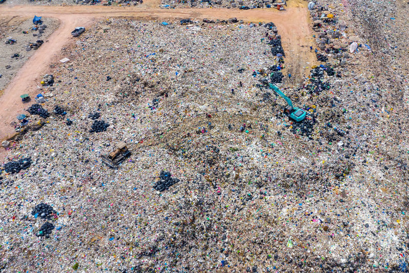 Aerial view of large landfill. Waste Garbage dump. High Angle View Day No People Land Beach Outdoors Nature Sand Dirt Water Pollution Water Backgrounds Dirty Pollution Full Frame Messy Environmental Issues Field Pattern Concrete