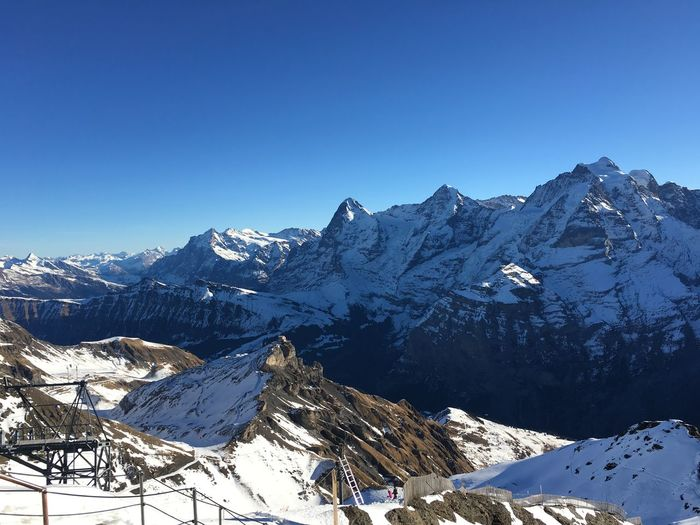 Alps Alps Switzerland Beauty In Nature Blue Clear Sky Cold Temperature Eiger Moench Jungfrau Famous Place Idyllic Mountain Nature Schilthorn Season  Snow Snowcapped Mountain Tourism Tranquil Scene Tranquility Travel Destinations Winter