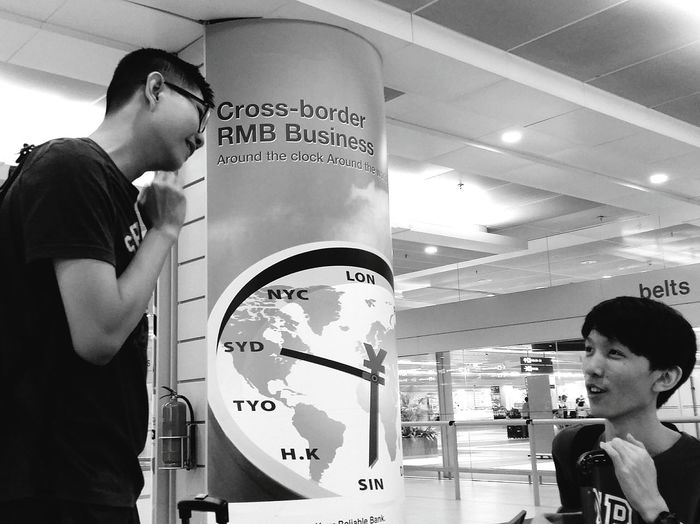 The boys are home Airport Changi Airport Tokyo To Singapore Bnw Bnw_captures Bnw_collection Bnw_streetphotography Streetphotography Singapore Eyeemphotography EyeEm Bnw Eyeem Streetphotography my son is not in this photo