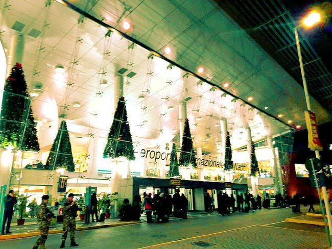 Airport Large Group Of People Illuminated Indoors  Christmas Men Real People Crowd Christmas Decoration People Day Travel Destinations Airport Waiting Airport Terminal Airportlife Airport Photography Airport Art Airportphotography Postcard Christmas Ornament Christmas Tree Night Building Exterior Low Angle View Scenics