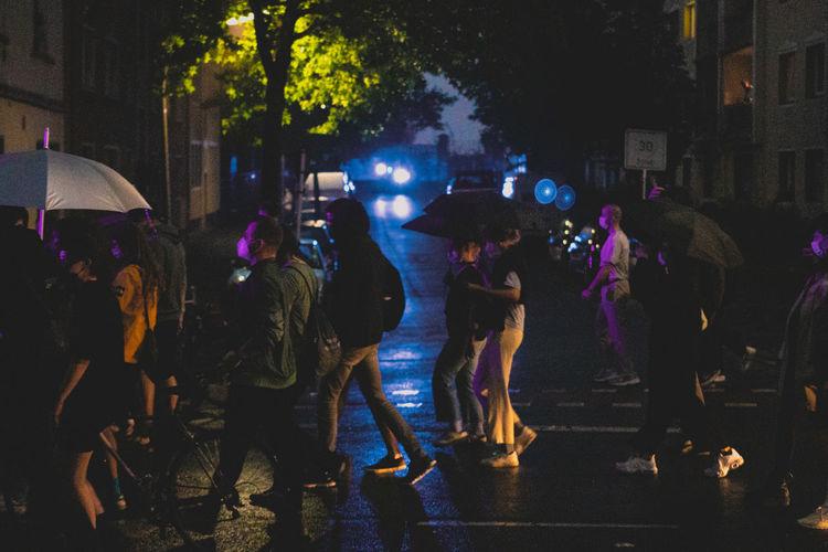 Group of people on wet street during rainy season