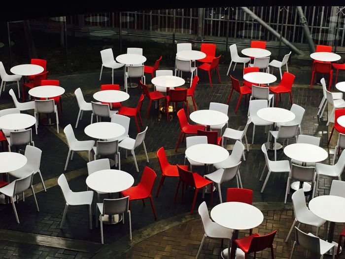 High Angle View Of Empty Chairs And Tables Arranged At Cafe