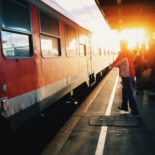 Train and people on platform at sunset